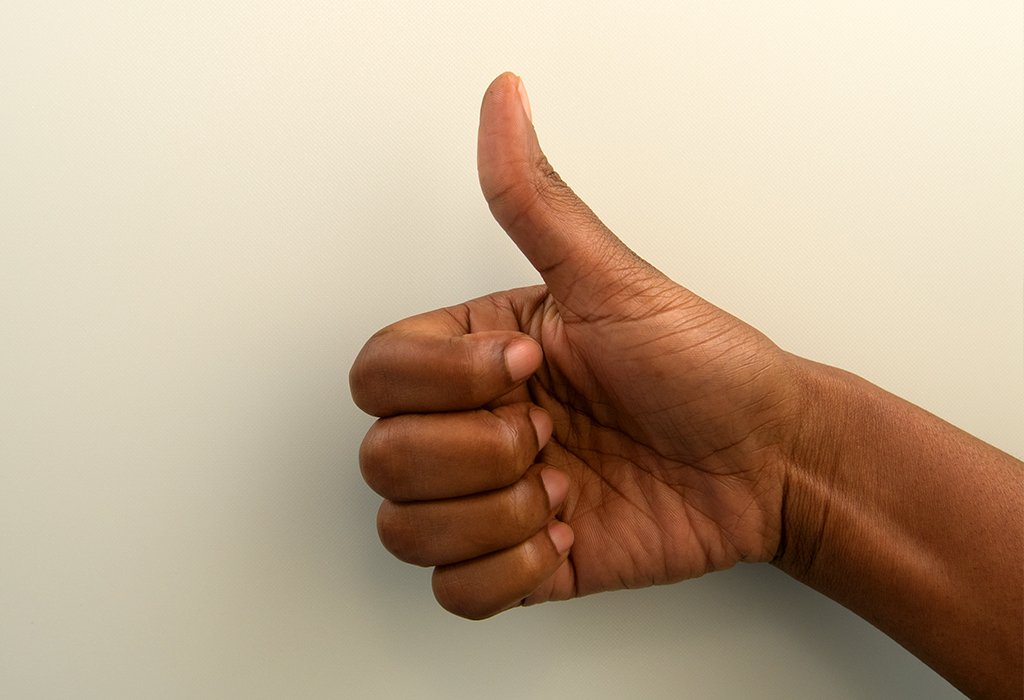 hand making thumbs up gesture to show thumb size