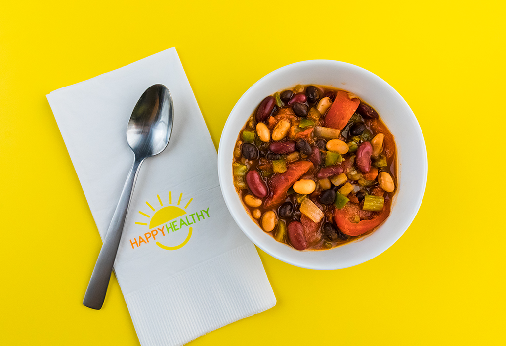 3 Bean Chili in a bowl with a spoon on a HappyHealthy napkin.