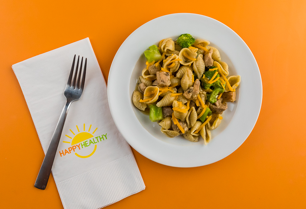 Chicken Broccoli Skillet recipe plated with a fork on a HappyHealthy napkin.