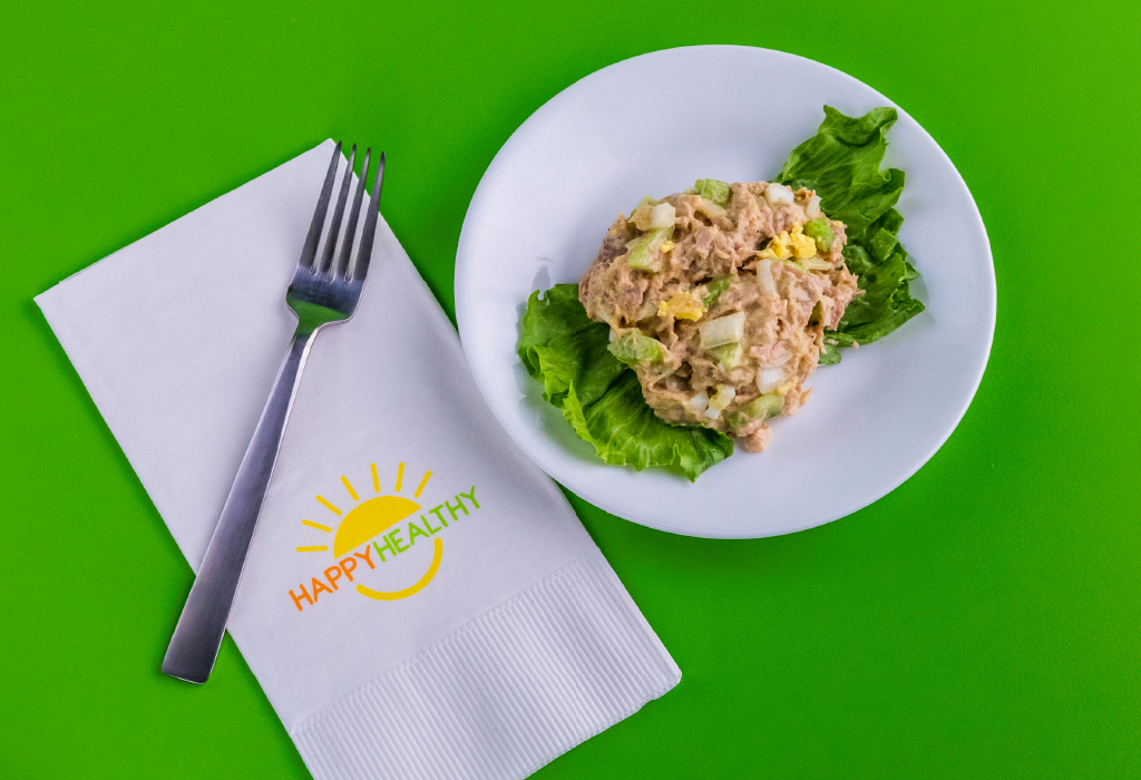 Plate of tuna salad by a fork with a napkin