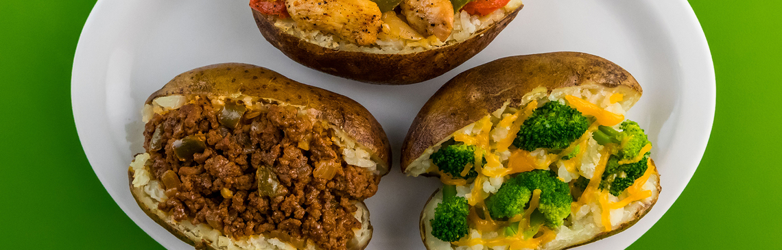 """3 baked potatoes one topped with """"One Pan Fajitas"""", one topped with """"Sloppy Joes"""", one topped with """"Steamed Broccoli with Grated Cheese"""""""