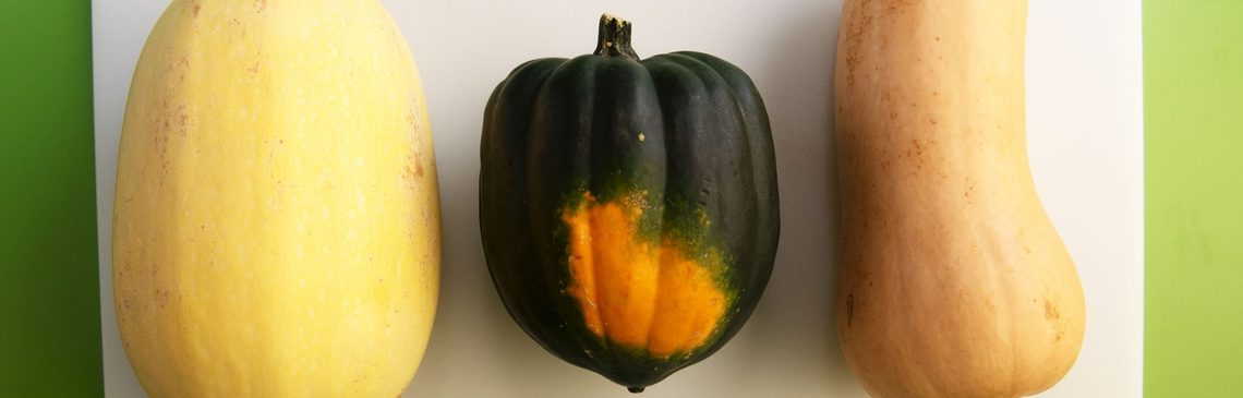 3 types of winter squash lined up on cutting board.