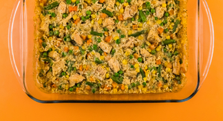 Chicken and rice casserole in glass baking dish.