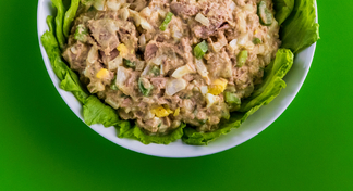 Bowl with tuna salad on bed of lettuce.
