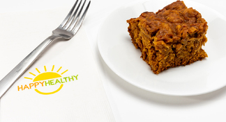 A pineapple pumpkin square on a white plate next two a fork and Happy Healthy napkin