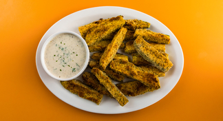 Plate with zucchini sticks and cup of low-fat ranch dressing.