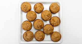 12 bran muffins on white square plate