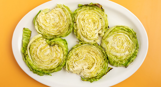 5 cabbage steaks on white plate