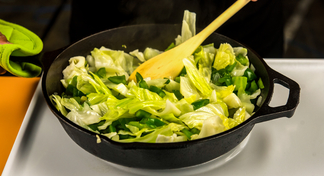 Chopped cabbage in an iron skillet.