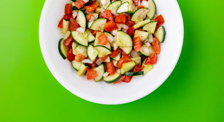 Cucumber Tomato Salad in white bowl
