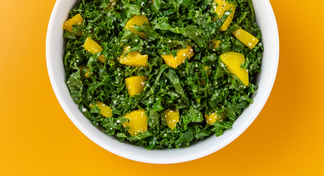 Kale salad in white bowl