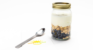 Jar of ingredients for overnight oats next to HappyHealthy napkin and spoon