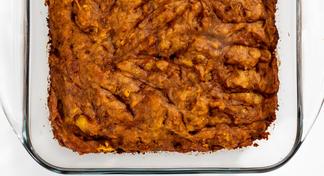 A baked pan of uncut pineapple pumpkin squares
