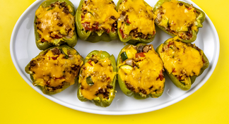 8 stuffed bell peppers on a white plate