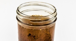 A glass jar of balsamic vinaigrette